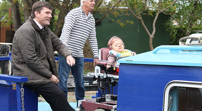Sophie Partridge getting onto an accessible boat