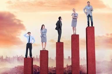 A graphical representation of people standing on the top of a chart.