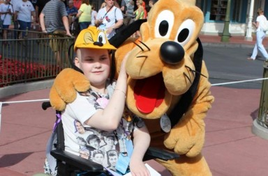 Nia-Turner-meets-Pluto-at-Magic-Kingdom,-Disney-World,-Florida