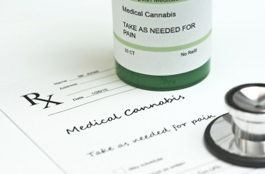 Medical marijuana prescription with bottle and stethoscope.