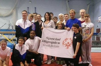 TeamGB holding up a flag with the Special Olympics logo on it