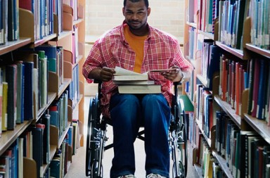man in a wheelchair in a library